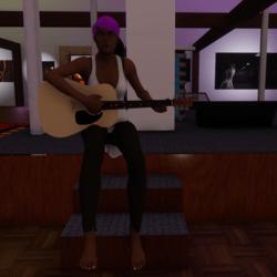 Female Guitar Sitting Down
